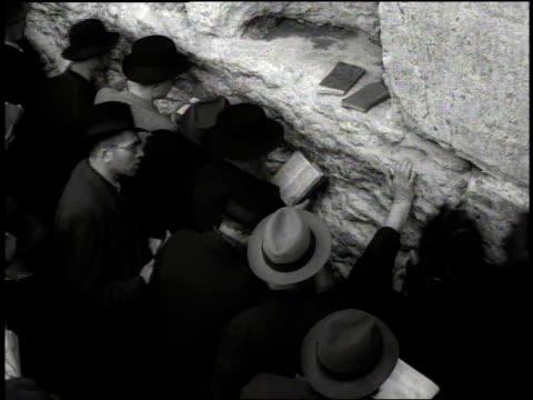 Jewish men pray in front of the Wall of Lamentation / Jerusalem Israel
