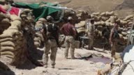 Jihadists occupying the Iraqi town of Sinjar are so close that Kurdish fighters can watch them without binoculars and battles are often fought with...