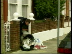 London Fulham Police officer tipping out bin as searching for evidence at scene of television presenter Jill Dando's murder CMS Police officer...