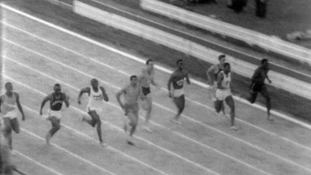 Jim Hines and Tommy Smith race at California relay on May 25 1967 in Modesto California