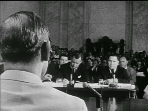 Jimmy Hoffa others sit at table / REAR VIEW head in foreground / Senate Labor hearings