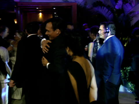 Jimmy Smits talks with Tom Hanks and Rita Wilson at The Vanity Fair Oscar Party