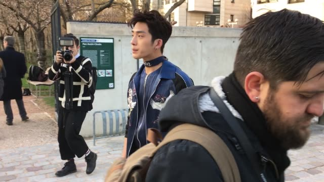 Jing Bo Ran attends the Louis Vuitton Menswear Fall/Winter 20162017 show At Parc Andre Citroen as part of Paris Fashion Week on January 21 2016 in...