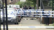 Court told of MP's final moments LIB / TX Lines of police tape cordons and police officers at the scene of the murder of Jo Cox Items left in the...