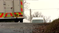 Clifton suspension bridge and body site Police vehicles parked in lane as officer along and forensics tent covering site where body was found just...