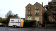 Flowers laid outside flat/prayer vigil at church ENGLAND Somerset Bristol EXT Windows of flat shared by murder victim Joanna Yeates and her boyfriend...