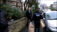 Landlord arrested Police at flats ENGLAND Somerset Bristol EXT Police officers and forensics officers carrying evidence bags from the building where...
