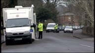 Police continue search of Canynge Road ENGLAND Bristol Policewoman along with torch and police car passes Police van and car along in cordonned off...