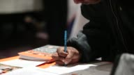 A job seeker fills out an application for Home Depot during a Giant Job Fair in Detroit Michigan US on Wednesday Dec 30 2015 The US Department of...