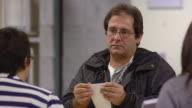 MS Job seeker talking to clerk at counter of state run job center / Jackson, Michigan, United States