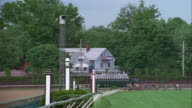 Jockeys race round corner of Churchill Downs racetrack, Louisville, Kentucky Available in HD.
