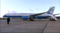 Joe Biden arrives at Stansted Airport ENGLAND Essex Stanstead Airport EXT USA plane taxiing on tarmac / American flag on tal of plane / GV plane on...