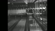 Joe Falcaro rolls a strike / CU Falcaro talking to camera / Falcaro knocks down three widely spaced pins / shot from in front of Falcaro as he rolls...