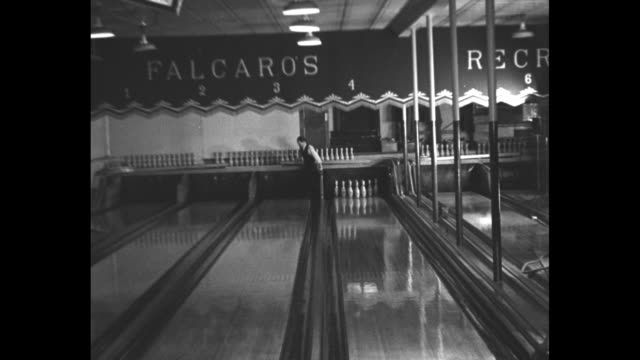 Joe Falcaro rolls a strike / CU Falcaro talking to camera / Falcaro knocks down three widely spaced pins / shot from in front of Falcaro as he rolls...