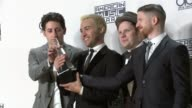 Joe Trohman Pete Wentz Patrick Stump and Andy Hurley Fall Out Boy at 2015 American Music Awards in Los Angeles CA
