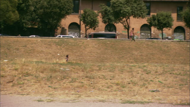 A jogger runs around the Circus Maximus below Palatine Hill.