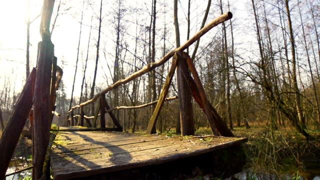 HD SUPER SLOW-MO: Jogging Across A Bridge