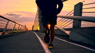 TS Jogging Across Bridge In The City