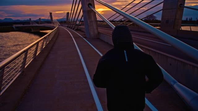 TS Jogging Across The Bridge At Dusk