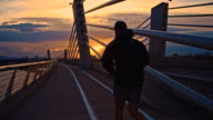 TS Jogging Across The Bridge At Sunset