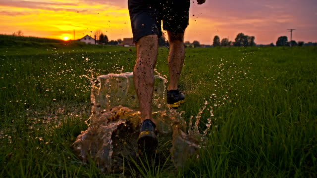 SLO MO Jogging Through Puddles At Sunset