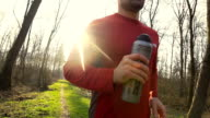HD SUPER SLOW-MO: Jogging With Bottle Of A Drink