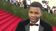 INTERVIEW John Boyega on keeping it fresh and no selfies at 'China Through The Looking Glass' Costume Institute Benefit Gala Arrivals at Metropolitan...
