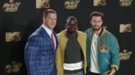 John Cena Daniel Kaluuya Aaron TaylorJohnson at 2017 MTV Movie And TV Awards Press Room in Los Angeles CA