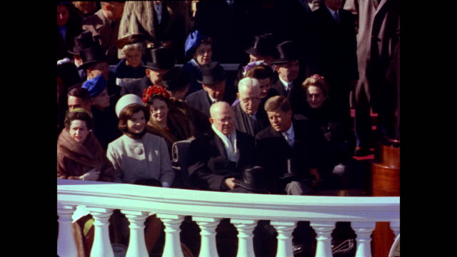 / John F Kennedy descends the steps of the Capitol Building to applause from the waiting crowd while accompanied by Senator Carl Hayden / Vice...