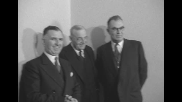 John Foster Dulles Martin P Durkin Leslie Munro pose at Eisenhower campaign headquarters at New York's Commodore Hotel