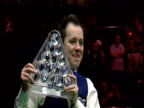 John Higgins poses with Masters trophy following his victory over Ronnie O'Sullivan in one of closest matches ever The Masters Final Wembley...