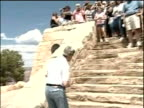 John Kerry and wife Teresa Heinz walk up steps to greet supporters on visit to Grand Canyon Aug 04