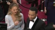 John Legend and Chrissy Teigen at 87th Annual Academy Awards Arrivals at Dolby Theatre on February 22 2015 in Hollywood California
