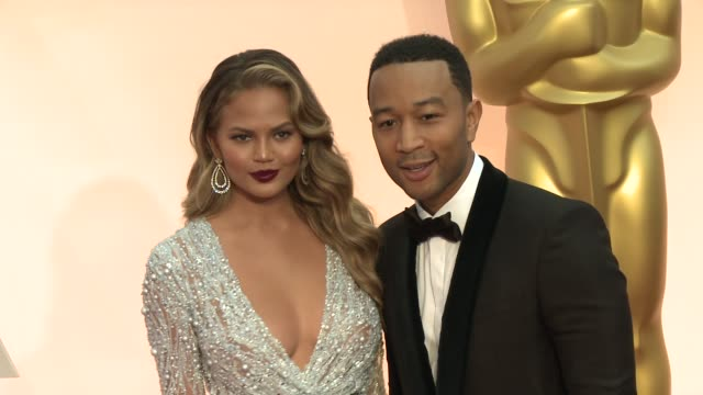 John Legend and Chrissy Teigen at the 87th Annual Academy Awards Arrivals at Dolby Theatre on February 22 2015 in Hollywood California