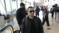INTERVIEW John Legend talks about Chrissy Teigen trolling him online as a joke while arriving LAX Airport Celebrity Sightings on April 27 2017 in Los...