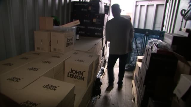 Trademark row as Beatles widow sues lemonade startup INT Karol Chamera moving boxes of John Lemon Reporter to camera 'John Lemon' lemonade bottles