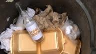 Trademark row as Beatles widow sues lemonade startup EXT Empty John Lemon lemonade bottles in bin with other rubbish