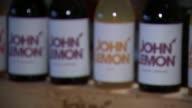 Trademark row as Beatles widow sues lemonade startup ENGLAND London INT **Music 'Imagine' by John Lennon overlaid SOT** Various shots of bottles of...
