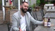 Trademark row as Beatles widow sues lemonade startup Karol Chamera carrying box of 'John Lemon' products Karol Chamera interview SOT Hand picking up...