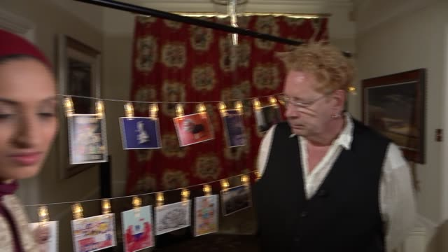 London INT John Lydon artworks John Lydon interview SOT re postcard competition / Brexit / Queen / NHS