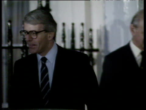 John Major and campaign team leaving 10 Downing Street and getting into car cameras flashing Major's Accession to Prime Ministership 27 Nov 90