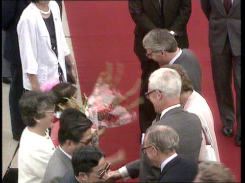 Beijing John Major out of aircraft with wife Norma PAN RL and to BV as to top of aircraft steps LA Major and Norma down steps TMS Major and Norma...
