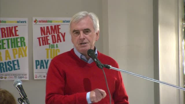 John McDonnell speech to Trade Union Conference fringe meeting ENGLAND Sussex Brighton INT TUC posters on table during meeting / John McDonnell MP...