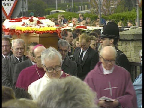 John Paul Gilhooley funeral Liverpool John Paul's funeral procession along parents and mourners with coffin Fr Michael Lee SOF mourners crying