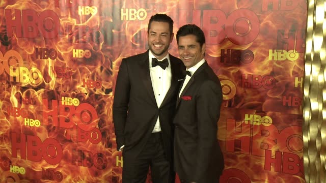 John Stamos and Zachary Levi at the 2015 HBO Emmy After Party at The Plaza at the Pacific Design Center on September 20 2015 in Los Angeles California