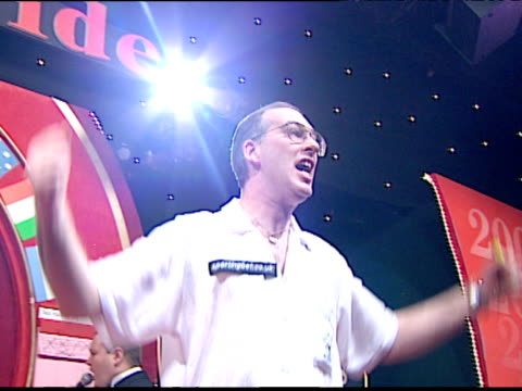John Walton celebrates victory over Ted Hankey in Embassy World Darts Championships final 2001