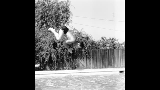 GIF Johnny Carson host of The Johnny Carson Show on CBS plays in his pool at home on July 5 1956 in Los Angeles California