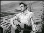 Johnny Cash playing guitar singing 'Home of the Blues' / farm backdrop / music video