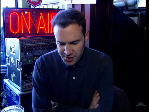 Johnny Vaughan broadcasts radio show from pub ITN London INT / Johnny Vaughan interviewed SOT / It's been fantastic like my desk / I waited til after...