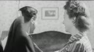 1943 MONTAGE John's wife tending his suit / United Kingdom